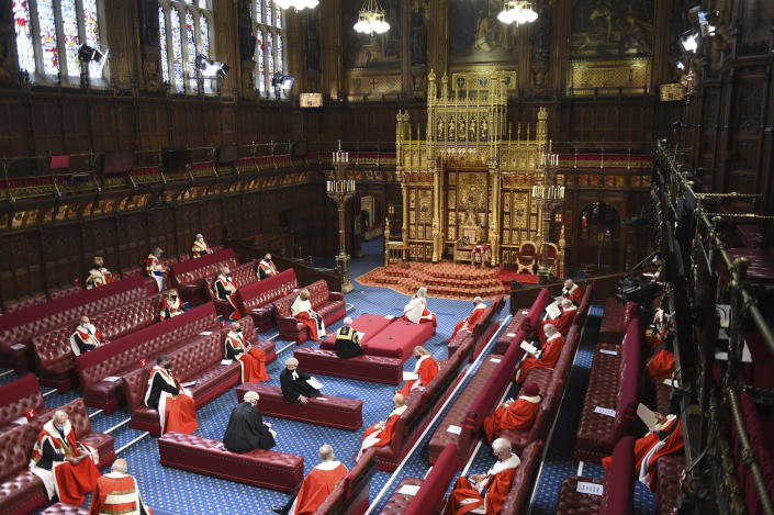 The House of Lords chamber before Britain's Queen Elizabeth II is to deliver a speech at the State Opening of Parliament in the House of Lords at the Palace of Westminster in London, Tuesday May 11, 2021. (Eddie Mulholland/Pool via AP)