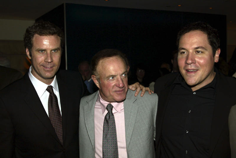 "Actors Will Ferrell, left, James Caan, center, and Jon Favreau attend the premiere party for the Movie ""Elf"" in New York, Nov. 2, 2003. (AP Photo/Mike Appleton) )"