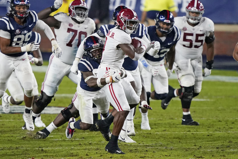 Alabama running back Brian Robinson Jr. (4) is tackled by a Mississippi defender during the first half of an NCAA college football game in Oxford, Miss., Saturday, Oct. 10, 2020. (AP Photo/Rogelio V. Solis)