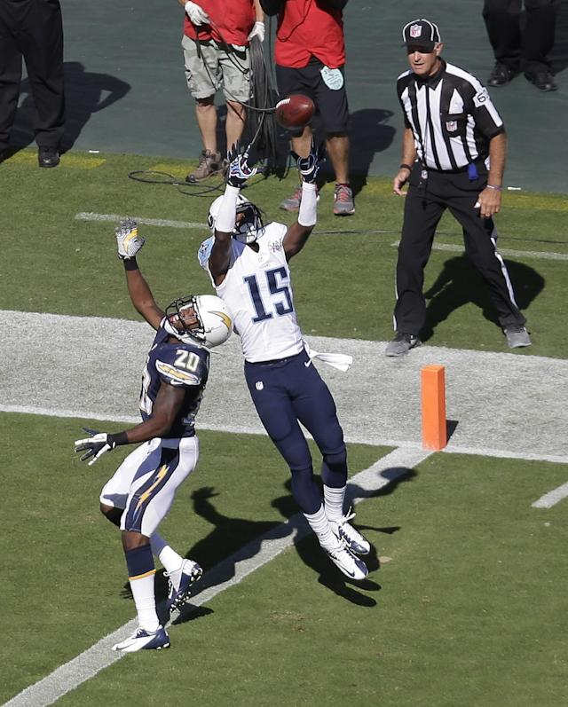Tennessee Titans wide receiver Justin Hunter (15) catches the game-winning touchdown pass on a 34-yard pass play as he is defended by San Diego Chargers cornerback Crezdon Butler (20) in the fourth quarter of an NFL football game on Sunday, Sept. 22, 2013, in Nashville, Tenn. The Titans won 20-17. (AP Photo/Mark Humphrey)