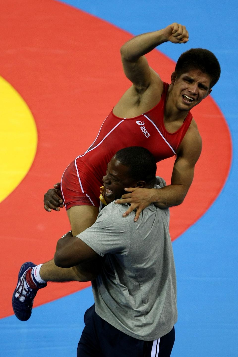 BEIJING - AUGUST 19: Henry Cejudo of the United States celebrates after defeating Shingo Matsumoto of Japan to win the gold medal in the men's 55kg freestyle wrestling event at the China Agriculture University Gymnasium on Day 11 of the Beijing 2008 Olympic Games on August 19, 2008 in Beijing, China. (Photo by Jed Jacobsohn/Getty Images)