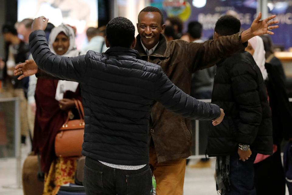 Faisal Etal, center, a Somali national who was delayed entry to the U.S. over thetravel ban, is greeted by his brother Adan Etal at Washington Dulles International Airport on Feb. 6, 2017.