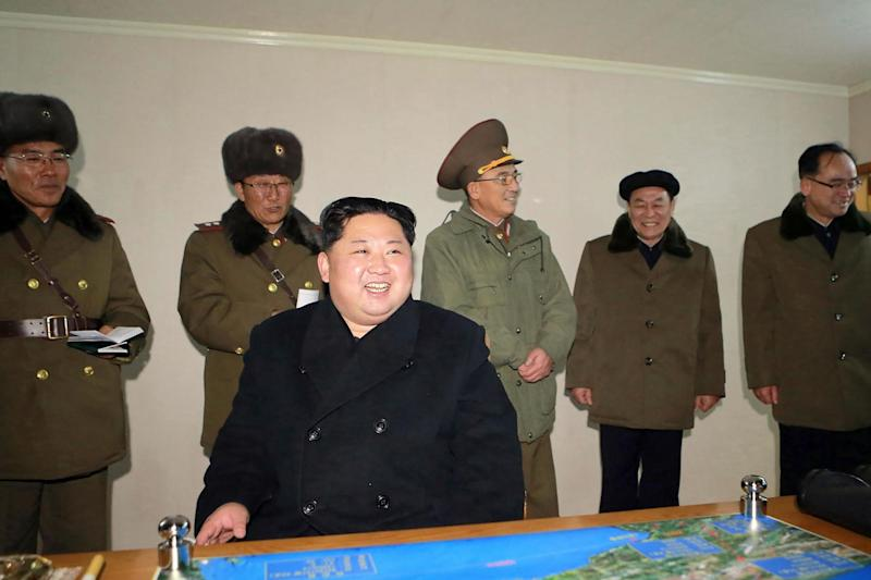 Kim Jong-Un laughs while analyising North Korea's latest missile launch, thought to be capable of reaching anywhere in the US: AFP/Getty Images