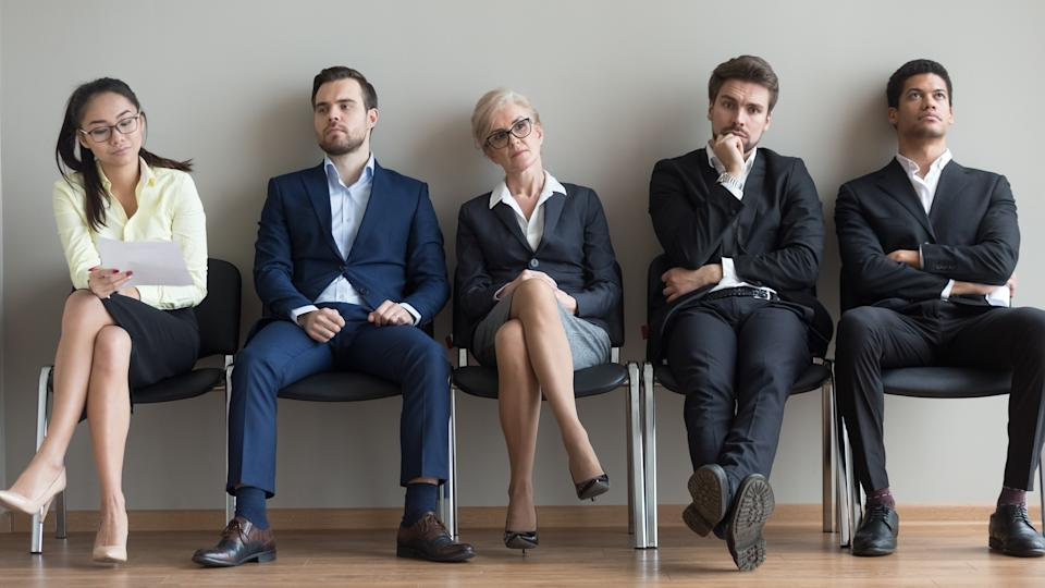 Diverse business people applicants waiting for their turn preparing for job interview sit in line queue, horizontal wide photo banner for website header design, human resources, job search concept