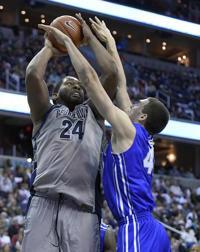 Georgetown center Joshua Smith (24) goes to the basket against Creighton forward Zach Hanson, right, during the second half of an NCAA college basketball game, Saturday, Jan. 3, 2015, in Washington. Georgetown won 76-61. (AP Photo/Nick Wass)