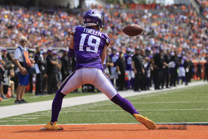 Minnesota Vikings wide receiver Adam Thielen (19) makes a catch for a touchdown against the Cincinnati Bengals in the first half of an NFL football game, Sunday, Sept. 12, 2021, in Cincinnati. (AP Photo/Aaron Doster)