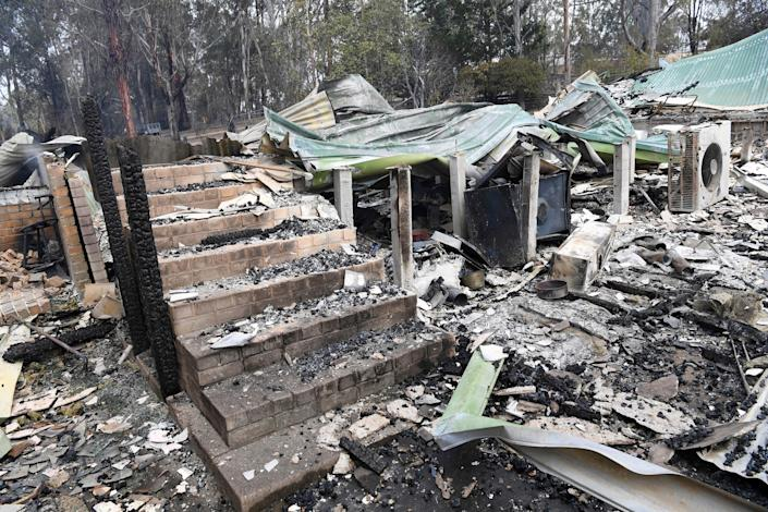 A burnt-out residence is seen in Sarsfield, East Gippsland, Victoria,.