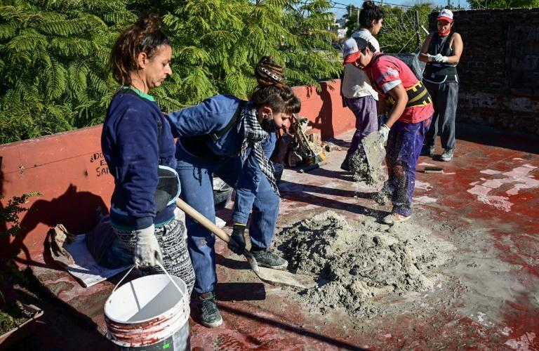Female builders working on a house in Valentin Alsina in Buenos Aires province