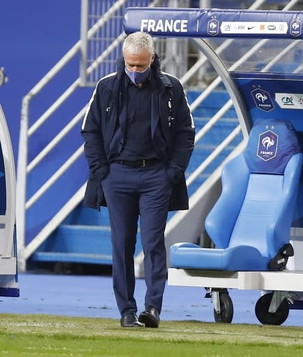France's head coach Didier Deschamps walks next to the bench during the UEFA Nations League soccer match between France and Sweden at the Stade de France stadium in Saint-Denis, northern Paris, Tuesday, Nov. 17, 2020. (AP Photo/Francois Mori)