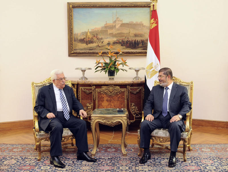 """In this photo, released by the Egyptian Presidency, Palestinian President Mahmoud Abbas, left, meets with  Egyptian President Mohammed Morsi, right, in Cairo Egypt, Tuesday, Nov. 13, 2012. In a meeting in Cairo Tuesday with Western-backed Palestinian President Mahmoud Abbas, Morsi expressed his """"full support"""" for Palestinian plans to seek nonmember state status at the United Nations.(AP Photo/Egyptian Presidency)"""