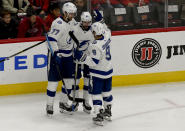 Tampa Bay Lightning right wing Nikita Kucherov, center, celebrates with defenseman Victor Hedman (77) and center Tyler Johnson (9) after scoring a goal against the Chicago Blackhawks during the first period of an NHL hockey game on Sunday Oct. 21, 2018, in Chicago. (AP Photo/Matt Marton)
