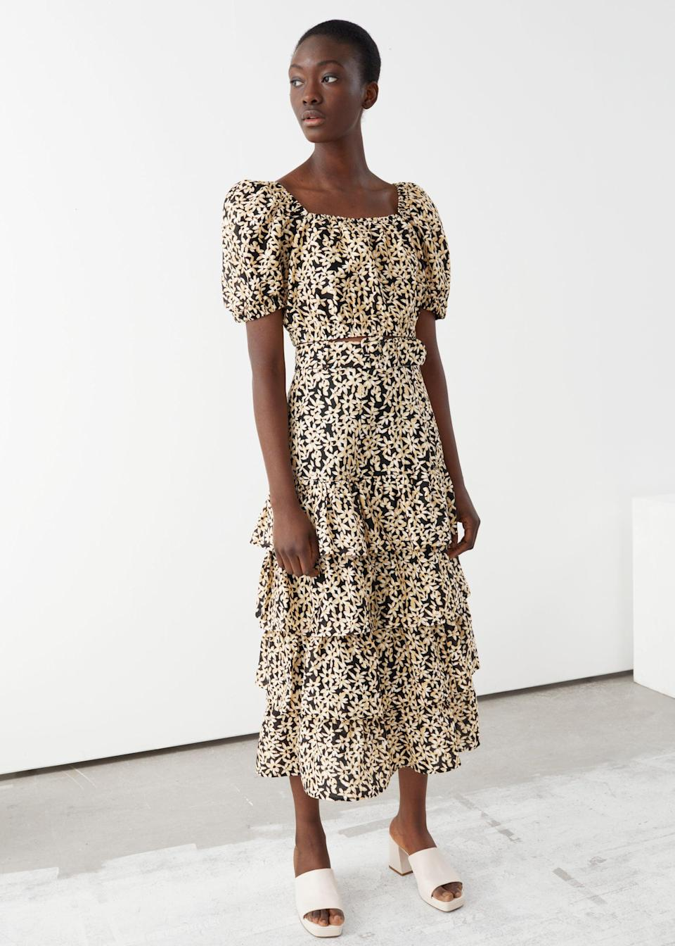 """<br> <br> <strong>& Other Stories</strong> Belted Floral Ruffle Midi Skirt, $, available at <a href=""""https://go.skimresources.com/?id=30283X879131&url=https%3A%2F%2Fwww.stories.com%2Fen_usd%2Fclothing%2Fdresses%2Fmidi-dresses%2Fproduct.belted-floral-ruffle-midi-skirt-black.0859814001.html"""" rel=""""nofollow noopener"""" target=""""_blank"""" data-ylk=""""slk:& Other Stories"""" class=""""link rapid-noclick-resp"""">& Other Stories</a>"""