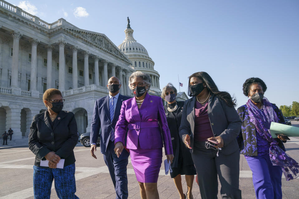 Members of the Congressional Black Caucus walk to make a make a statement on the verdict in the murder trial of former Minneapolis police Officer Derek Chauvin in the death of George Floyd, on Capitol Hill in Washington, Tuesday, April 20, 2021.  / Credit: J. Scott Applewhite / AP