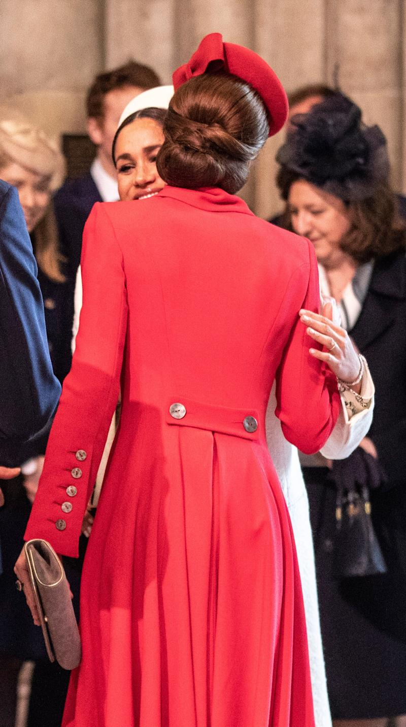 The Duchess of Sussex and the Duchess of Cambridge greet each other at the Commonwealth Day Service.