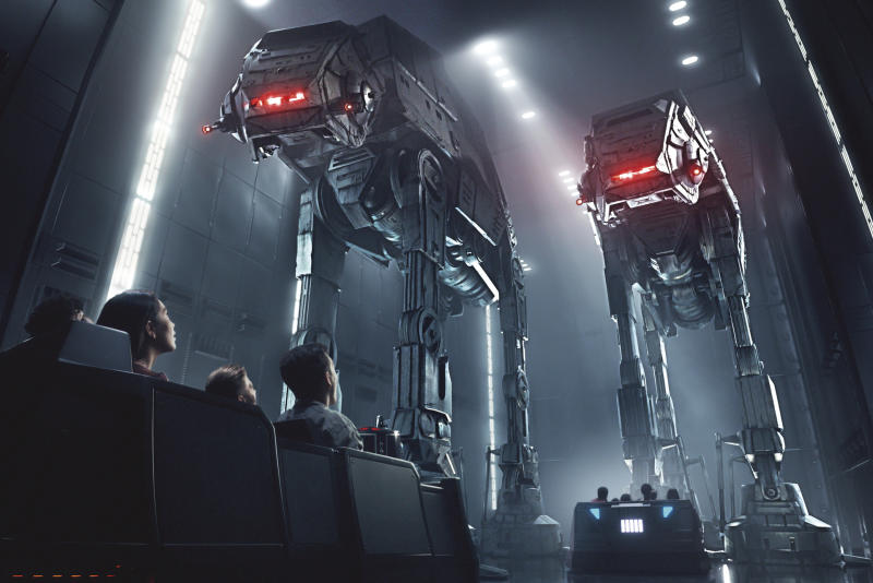 This rendering released by Disney and Lucasfilm shows people on the planned Star Wars: Rise of the Resistance attraction, part of Star Wars: Galaxy's Edge. The 14-acre area set to open this summer at the Disneyland Resort in Anaheim, California, then in the fall at Disney's Hollywood Studios in Orlando, Florida. (Disney Parks/Lucasfilm via AP)