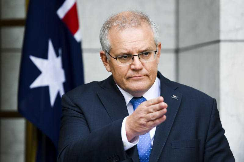 Australian Prime Minister Scott Morrison speaks to the media during a press conference following a national cabinet meeting, at Parliament House in Canberra.