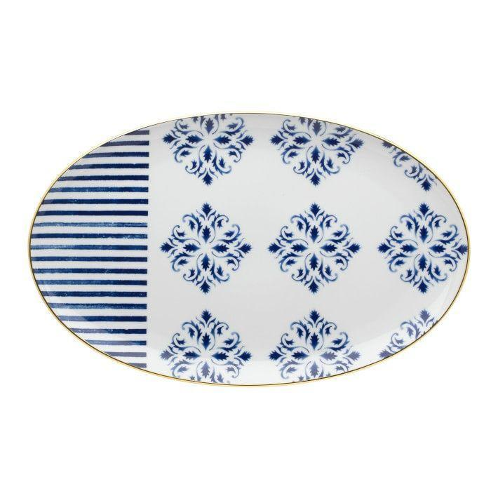 """<p>williams-sonoma.com</p><p><strong>$155.00</strong></p><p><a href=""""https://go.redirectingat.com?id=74968X1596630&url=https%3A%2F%2Fwww.williams-sonoma.com%2Fproducts%2Ftransatlantica-platter&sref=https%3A%2F%2Fwww.womenshealthmag.com%2Ffood%2Fg32904831%2Fbest-serving-platters%2F"""" rel=""""nofollow noopener"""" target=""""_blank"""" data-ylk=""""slk:Shop Now"""" class=""""link rapid-noclick-resp"""">Shop Now</a></p><p>Think of this platter as fine china without the hefty price tag. This porcelain serving platter was designed with with touches of hand-painted 24k gold and features a nautical theme. </p>"""