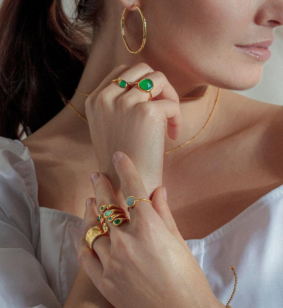 """<p>monicavinader.com</p><p><strong>$150.00</strong></p><p><a href=""""https://go.redirectingat.com?id=74968X1596630&url=https%3A%2F%2Fwww.monicavinader.com%2Fus%2Fsiren-medium-stacking-ring%2Fgold-vermeil-siren-medium-stacking-ring-green-onyx%3Fsearch%3D%252Fshop%252Fby-collection%252Fsiren-1%252Fsort-by%252Fbest-sellers%253Fpage%253D2%26ajaxCache%3D1%26countryCache%3DUS%26currencyCache%3DUSD%26ranMID%3D38783%26ranEAID%3DTnL5HPStwNw%26ranSiteID%3DTnL5HPStwNw-v.bugZJeVZZEPBNIFMonIg%26siteID%3DTnL5HPStwNw-v.bugZJeVZZEPBNIFMonIg&sref=https%3A%2F%2Fwww.townandcountrymag.com%2Fstyle%2Fjewelry-and-watches%2Fg34464609%2Fkate-middleton-meghan-markle-wear-monica-vinader-jewelry%2F"""" rel=""""nofollow noopener"""" target=""""_blank"""" data-ylk=""""slk:Shop Now"""" class=""""link rapid-noclick-resp"""">Shop Now</a></p>"""