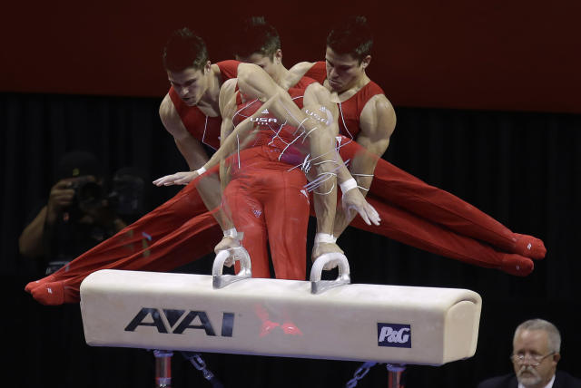In this multiple exposure photo taken at one-quarter second intervals, Chris Brooks competes on the pommel horse during the final round of the men's Olympic gymnastics trials, Saturday, June 30, 2012, in San Jose, Calif. (AP Photo/Julie Jacobson)