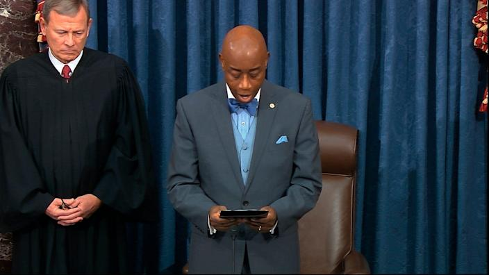 In this image from video, as presiding officer Chief Justice of the United States John Roberts listens Senate chaplain retired Navy Adm. Barry Black gives the opening prayer during the impeachment trial against President Donald Trump in the Senate at the U.S. Capitol in Washington, Wednesday, Jan. 29, 2020. (Senate Television via AP) ORG XMIT: DCJE102