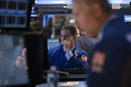 Traders work on the floor of the New York Stock Exchange June 23, 2014. REUTERS/Brendan McDermid