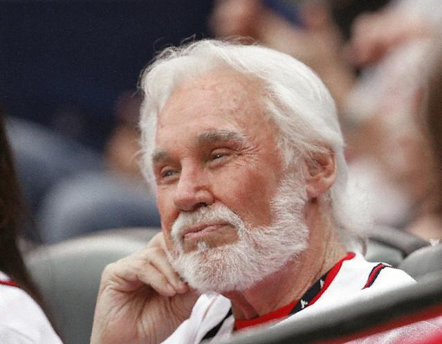 Country music recording artist Kenny Rogers looks on before the start of a of a baseball game between the Miami Marlins and Atlanta Braves in Atlanta, Monday, July 21, 2014. (AP Photo/John Bazemore)