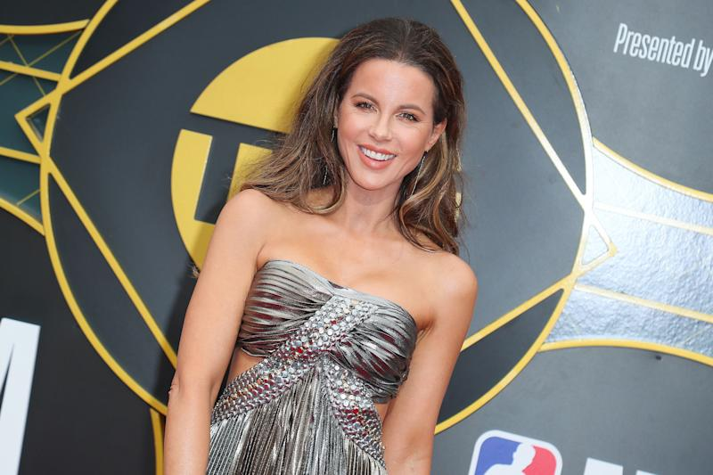 Kate Beckinsale poses at an event