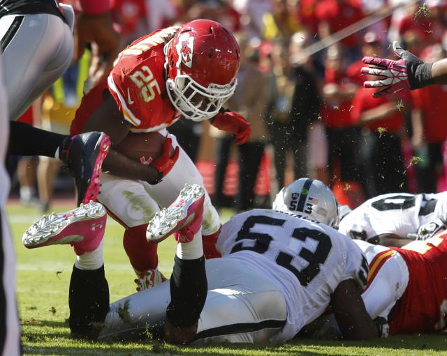 Kansas City Chiefs running back Jamaal Charles (25) scores a touchdown over Oakland Raiders middle linebacker Nick Roach (53) during the second half of an NFL football game at Arrowhead Stadium in Kansas City, Mo., Sunday, Oct. 13, 2013. (AP Photo/Ed Zurga)