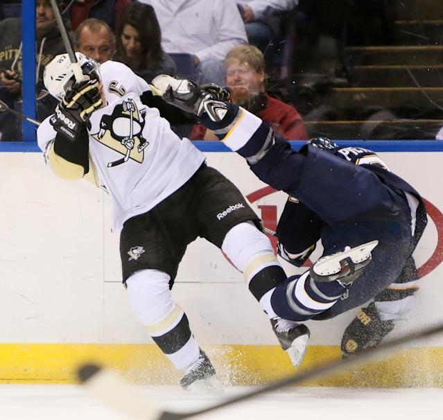 St. Louis Blues defenseman Alex Pietrangelo, right, collides with Pittsburgh Penguins center Sidney Crosby in second-period NHL hockey game action on Saturday, Nov. 9, 2013, in St. Louis. (AP Photo/St. Louis Post-Dispatch, Chris Lee)