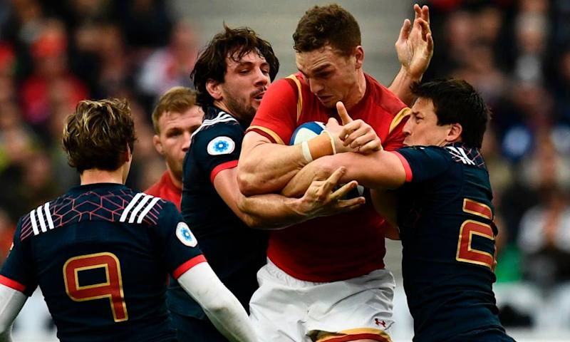 Wales' wing George North is tackled
