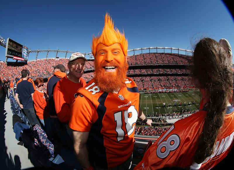 Denver Broncos fan Nick Hess, of Longmont, Colo., shows off his colors in Sports Authority Field at Mile High Stadium during the start of the AFC Championship NFL football playoff game as the Broncos host the New England Patriots on Sunday, Jan. 19, 2014, in Denver