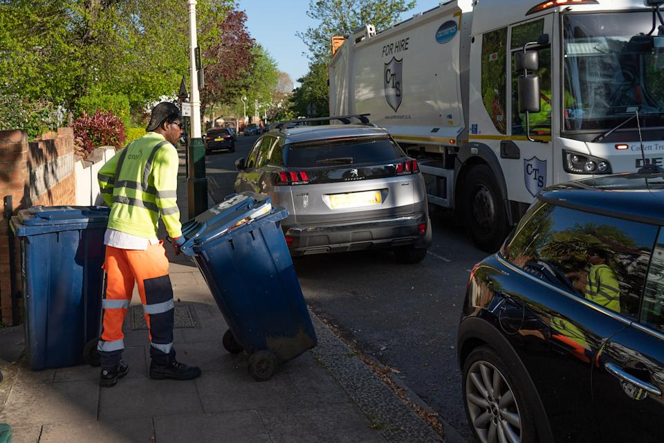 Refuse collectors working in a street in Ealing. Key workers have been praised for keeping services going during the coronavirus pandemic crisis. Photo date: Tuesday, April 21, 2020. Photo credit should read: Richard Gray/EMPICS