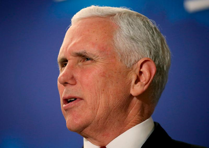 """FILE - In this March 22, 2018 file photo, Vice President Mike Pence speaks at the America First Policies, """"Tax Cuts to Put America First"""" event in Manchester, N.H. Pence plans to meet with four Latin American leaders during his weekend trip to Peru for an international summit where he is filling in for President Donald Trump.  (AP Photo/Mary Schwalm)"""