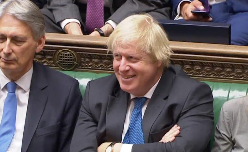 Boris Johnson chuckles as Jeremy Corbyn makes fun of Tory divisions on Brexit. (Photo: )