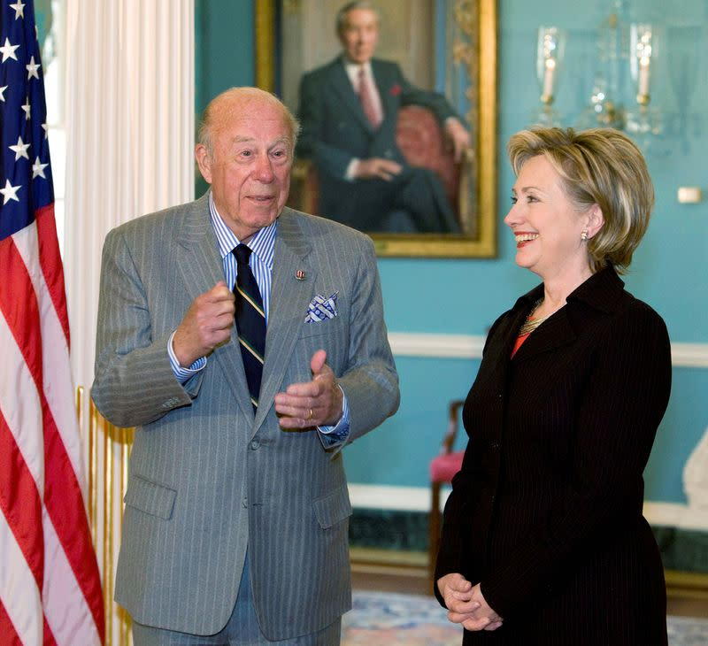 FILE PHOTO: U.S. Secretary of State Hilary Clinton meets with former Secretary of State Shultz in Washington