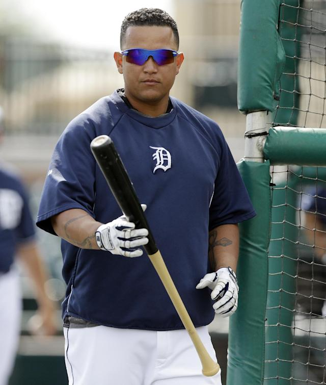 Detroit Tigers first baseman Miguel Cabrera prepares for batting practice before a spring exhibition baseball game against the Tampa Bay Rays in Lakeland, Fla., Friday, March 28, 2014. (AP Photo/Carlos Osorio)