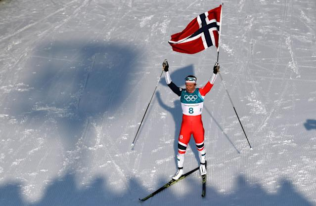 "Cross-Country Skiing - Pyeongchang 2018 Winter Olympics - Women's 30km Mass Start Classic - Alpensia Cross-Country Skiing Centre - Pyeongchang, South Korea - February 25, 2018 - Marit Bjoergen of Norway celebrates winning the race holding a Norway flag. REUTERS/Toby Melville SEARCH ""OLYMPICS BEST"" FOR ALL PICTURES. TPX IMAGES OF THE DAY."