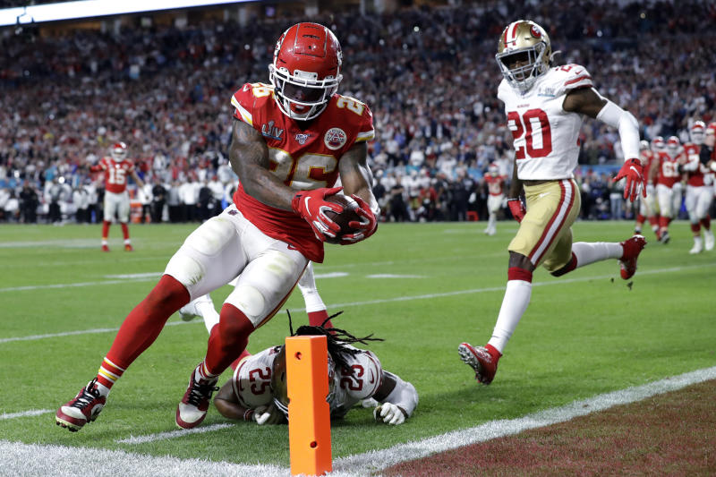 Kansas City Chiefs' Damien Williams (26) scores a touchdown against the San Francisco 49ers in Super Bowl LIV. (AP Photo/Mark Humphrey)