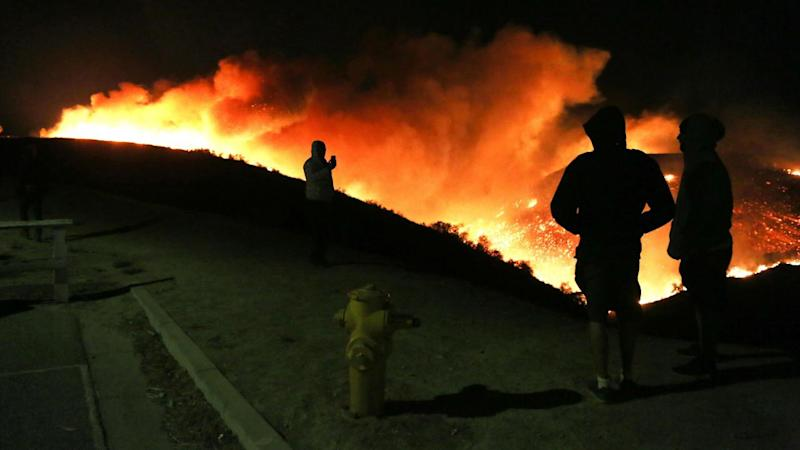 As a massive brush fire spread through parts of Ventura county on Tuesday, celebrities reacted via social media.