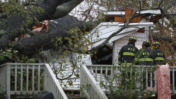 PHOTO: Firefighters arrive at a home where a large tree fell trapping people inside, after Hurricane Florence hit the area, Sept. 14, 2018 in Wilmington, N.C. (Mark Wilson/Getty Images)