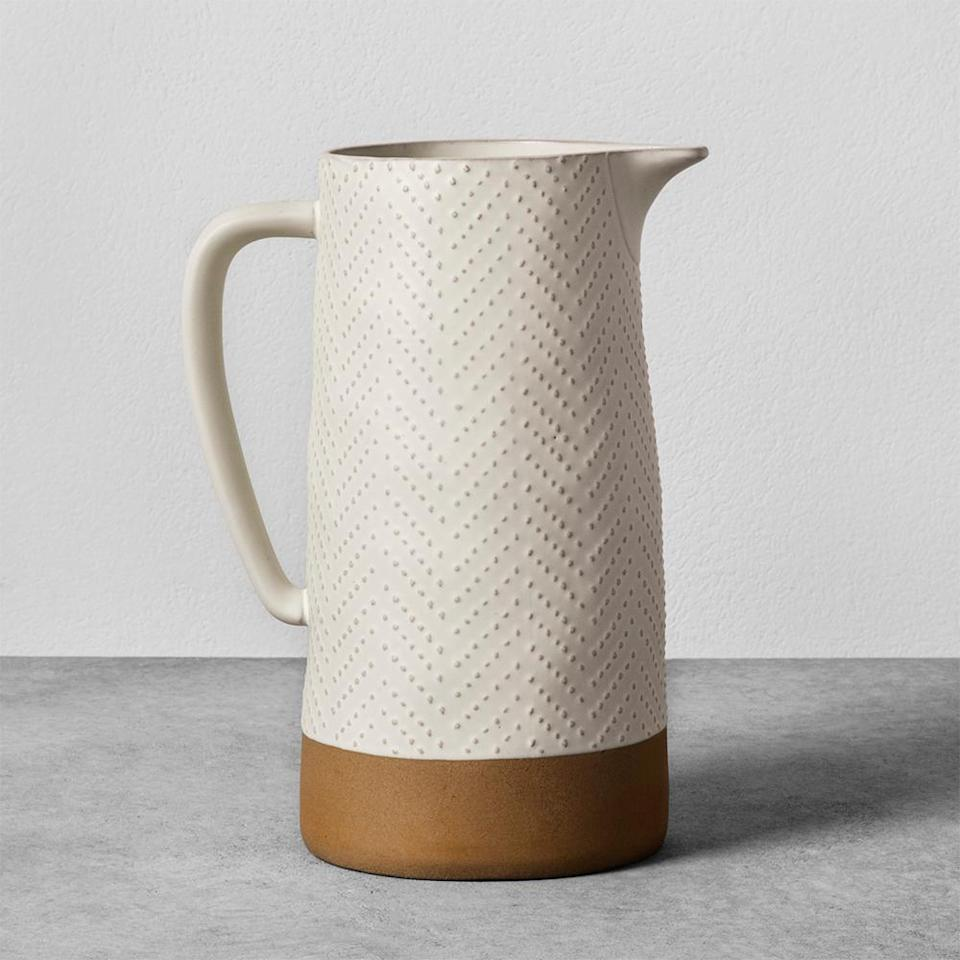 "<p>There's something very versatile about this pitcher's rustic-meets-modern design. The kitchen basic can easily double as a vase, and its neutral coloring will complement any aesthetic. <br><strong><a href=""https://fave.co/2ArExbE"" rel=""nofollow noopener"" target=""_blank"" data-ylk=""slk:SHOP IT"" class=""link rapid-noclick-resp"">SHOP IT</a>:</strong> $21 (on sale, $15),<a href=""https://fave.co/2ArExbE"" rel=""nofollow noopener"" target=""_blank"" data-ylk=""slk:target.com"" class=""link rapid-noclick-resp""> target.com</a> </p>"