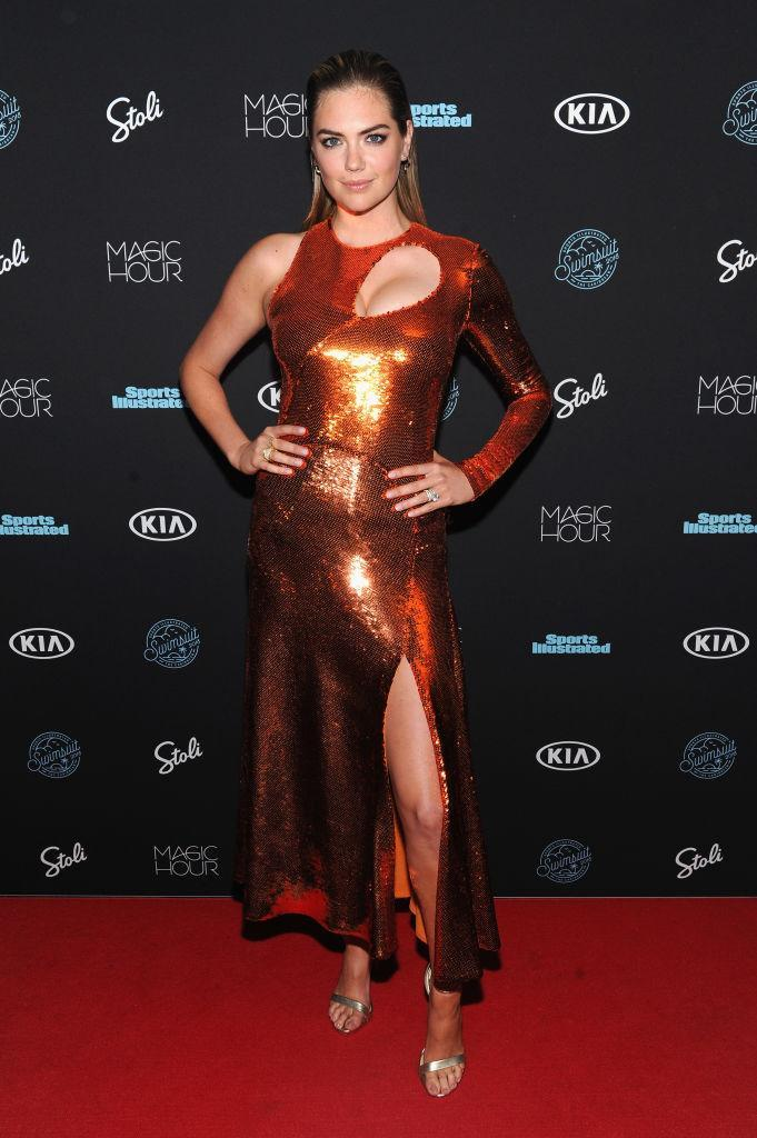 <p>Kate Upton donned this season's most debated trend, metallic hues, at the Sports Illustrated party in New York. She finished the aesthetic with slick hair and nineties-inspired heels. <em>[Photo: Getty]</em> </p>