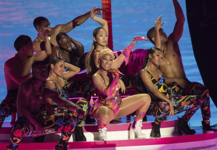 FILE - This Nov. 4, 2018 file photo shows singer Nicki Minaj performing at the European MTV Awards in Bilbao, Spain. Minaj is pulling out a concert in Saudi Arabia because she says she wants to show support for women's rights, gay rights and freedom of expression. She was originally scheduled to headline the concert on July 18. The Human Rights Foundation issued a statement last week, calling for Minaj and other performers to pull out of the show. (Photo by Vianney Le Caer/Invision/AP, File)