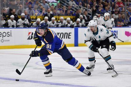 May 15, 2019; St. Louis, MO, USA; St. Louis Blues right wing Vladimir Tarasenko (91) handles the puck as San Jose Sharks center Logan Couture (39) defends during the second period in game three of the Western Conference Final of the 2019 Stanley Cup Playoffs at Enterprise Center. Mandatory Credit: Jeff Curry-USA TODAY Sports