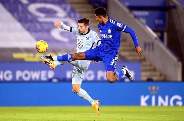 Chelsea's Christian Pulisic and Leicester's Wesley Fofana challenge for the ball
