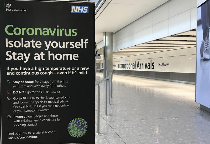 A sign at Heathrow Airport Terminal 5 arrivals warns of Coronavirus, in London, Tuesday, March 24, 2020. Britain's Prime Minister Boris Johnson on Monday imposed its most draconian peacetime restrictions due to the spread of the coronavirus on businesses and social gatherings. For most people, the new coronavirus causes only mild or moderate symptoms. For some it can cause more severe illness.(AP Photo/Kirsty Wigglesworth)