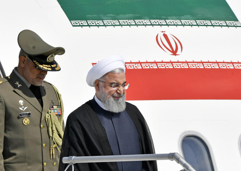 Iranian President Hassan Rouhani, right, arrives at the Zurich airport, in Kloten, Switzerland. Monday, July 2, 2018. Hassan Rouhani is on a two day state visit to Switzerland(KEYSTONE/Walter Bieri)