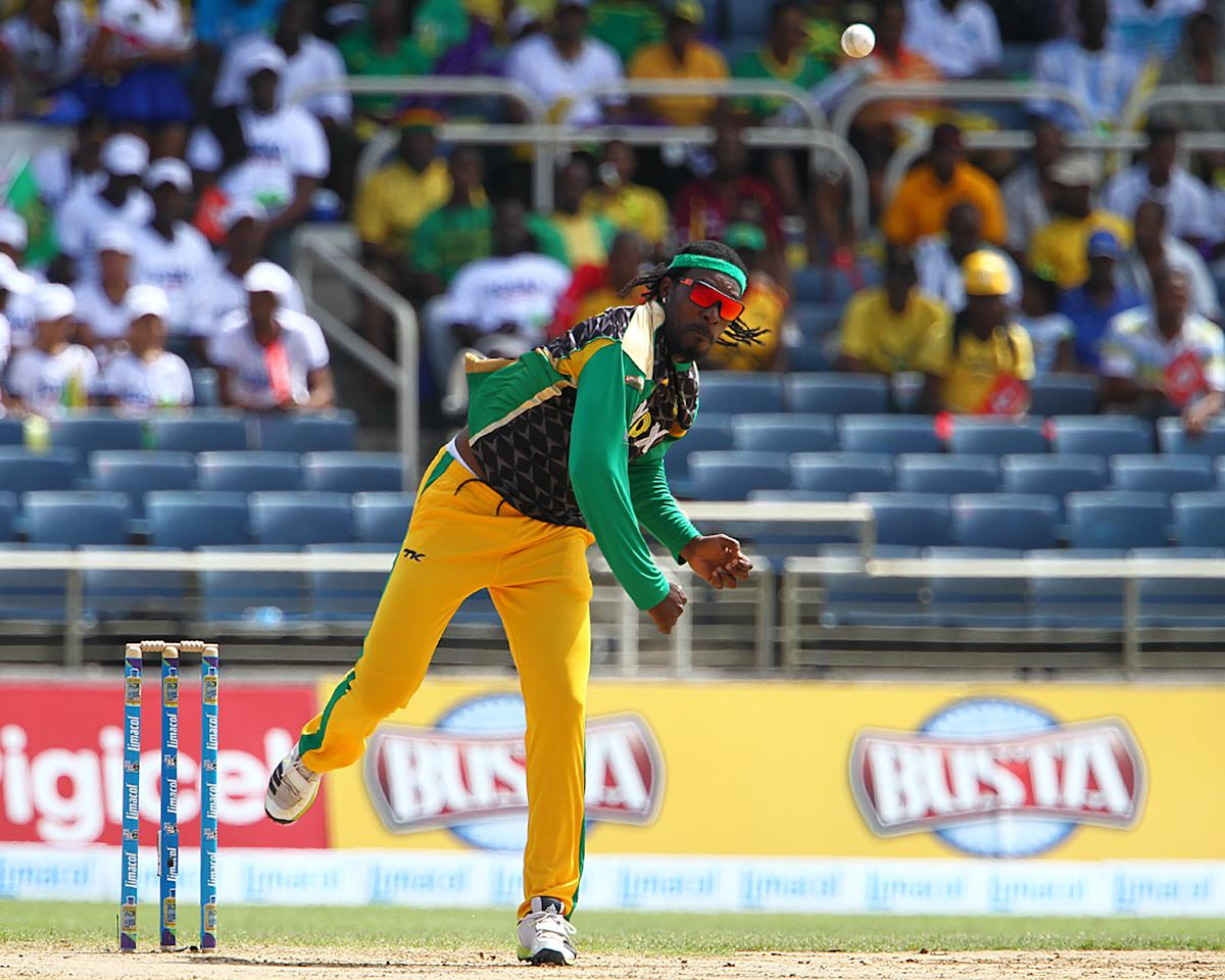 KINGSTON, JAMAICA - AUGUST 15: Chris Gayle bowls during the Sixteenth Match of the Cricket Caribbean Premier League between Jamaica Tallawahs v Guyana Amazon Warriors at Sabina Park on August 15, 2013 in Kingston, Jamaica. (Photo by Ashley Allen/Getty Images Latin America for CPL)