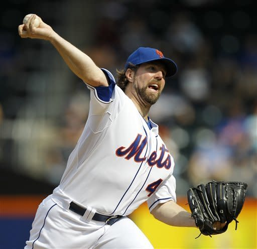New York Mets starting pitcher R.A. Dickey, who is trying for his 20th victory, delivers in the first inning against the Pittsburgh Pirates during their baseball game at Citi Field in New York, Thursday, Sept. 27, 2012. (AP Photo/Kathy Willens)