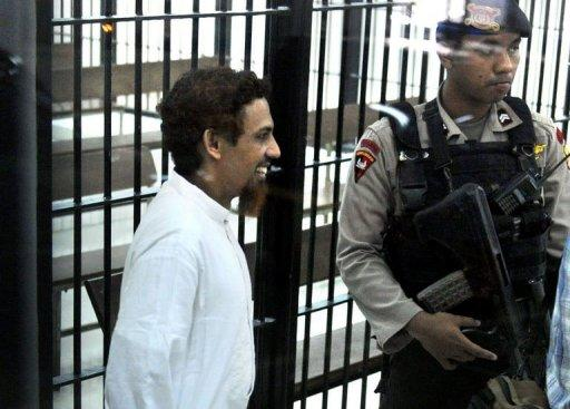 "Indonesian terror suspect Umar Patek is escorted to court in Jakarta on June 21, 2012. An Indonesia court is due to hand down its verdict Thursday against Patek, dubbed ""Demolition Man"", for his role in the 2002 Bali bombings, bringing a 10-year probe into the nation's deadliest act of terror to a close"